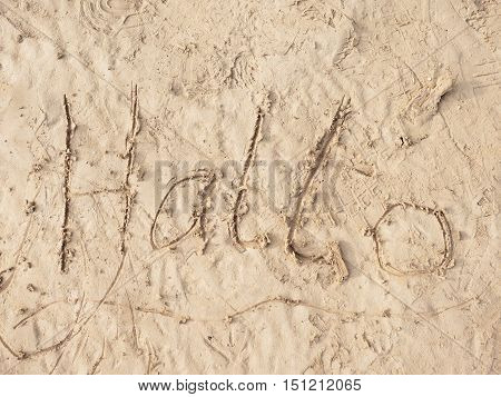 Children Drawing Of Word Hallo In Sand On Beach Of Bay. Letters Written In Sand.