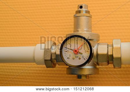 Pressure reducer with manometer on polypropylene water pipe