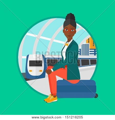 An african-american woman sitting on a suitcase at the train station. Young woman waiting for a train at the railway platform. Vector flat design illustration in the circle isolated on background.
