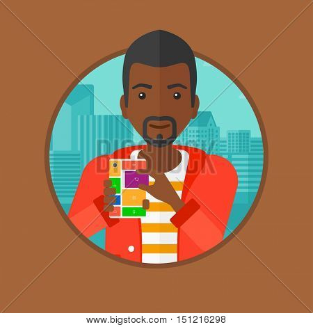 An african-american man holding modular phone. Young man with modular phone standing on a city background. Man using modular phone. Vector flat design illustration in the circle isolated on background