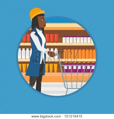 An african woman pushing supermarket cart. Young woman shopping at supermarket. Woman walking with supermarket trolley on aisle. Vector flat design illustration in the circle isolated on background.