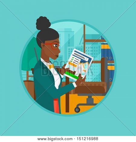 An african woman looking at house on a digital tablet screen. Woman standing in office and looking for house on tablet computer. Vector flat design illustration in the circle isolated on background.