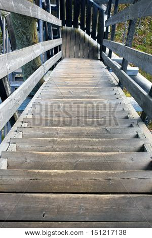 Wooden stairs down from a lookout tower.