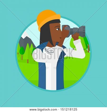 An african woman taking photo of landscape. Photographer taking picture in the mountains. Nature photographer with digital camera. Vector flat design illustration in the circle isolated on background.