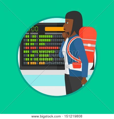 An african woman looking at departure board at the airport. Passenger standing at the airport in front of the departure board. Vector flat design illustration in the circle isolated on background.