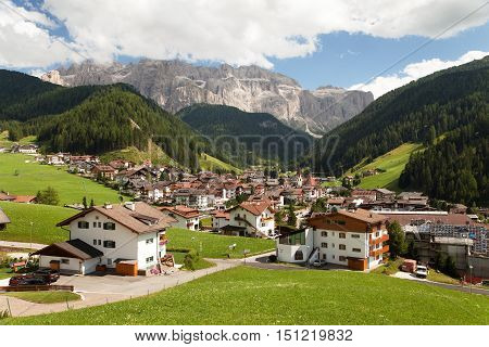 Selva Val Gardena or Wolkenstein a summer and winter holiday village in Val Gardena under Sellagrupe or Gruppo di Sella South Tirol Dolomiten mountains Italien European Alps