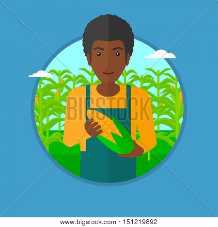 An african-american farmer holding a corn cob on the background of corn field. An african-american happy farmer collecting corn. Vector flat design illustration in the circle isolated on background.