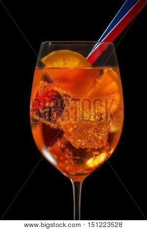 Aperol Spritz in glass, close up on black background