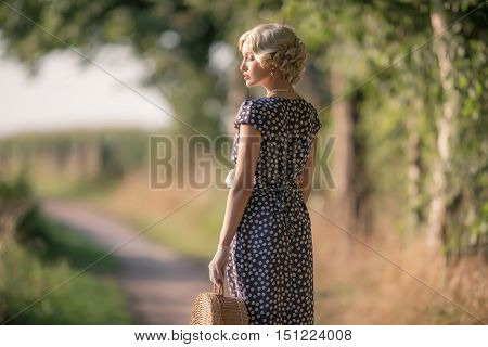 1930S Vintage Fashion Woman Standing With Handbag On Rural Pathway.