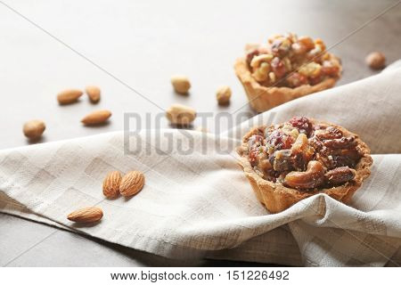 Delicious cakes with nuts on table