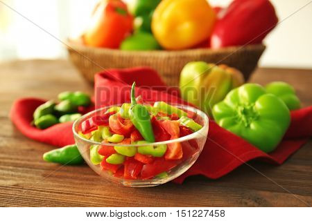 Fresh peppers on wooden table