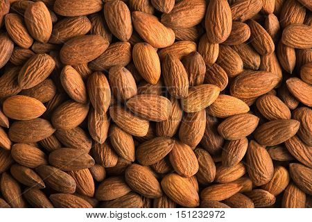 Peeled almonds closeup. For vegetarians. Almonds background.