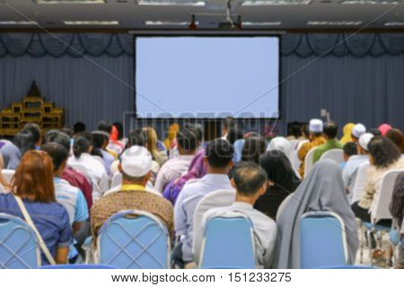 blurred focus  education business training conference  in room seminar meeting analyze Statistics Financial Concept with projector Movie screen.