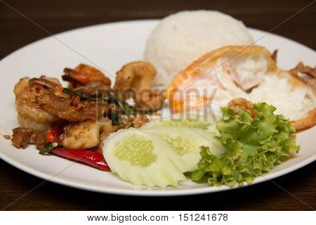 Image of Thai spicy seafood style with ri