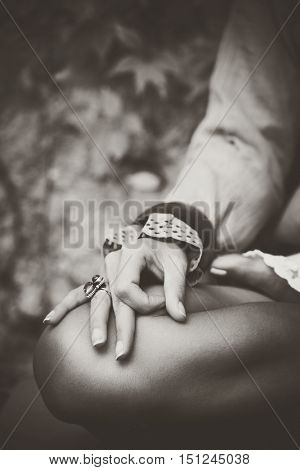 woman hand closeup in meditation yoga position desaturated photo