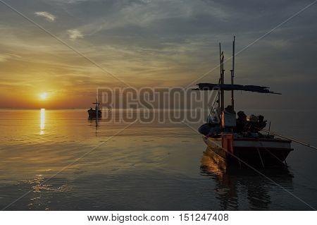 two fishing boats awaiting the rising tide