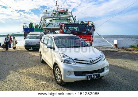 Menumbok,Sabah-Aug 19,2016:Vehicles landing from Labuan island at Menumbok,Sabah.Government will implementing Bank Guarantee on every duty free vehicles Labuan island due to losses of unpaid tax.