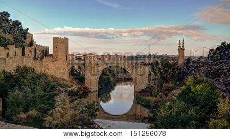 View to Alcantara bridge with reflection Toledo Spain