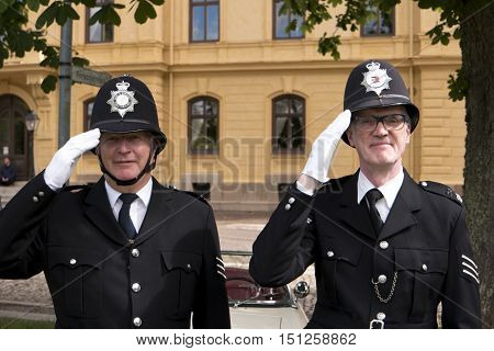 KARLSBORG SWEDEN - AUGUST 14 2016: Two London Bobbies posing in the Karlsborg Fortress in Sweden - editorial.