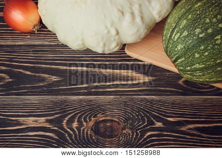 Fresh farmers garden vegetables on wooden table with copy space