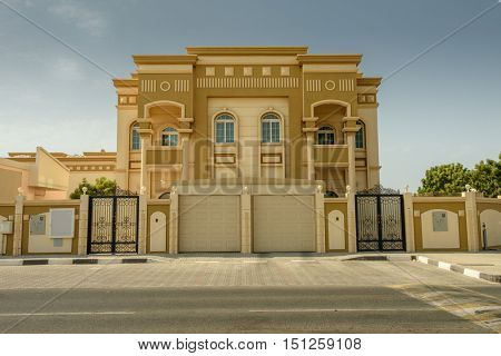 SHARJAH, UAE - OCTOBER 10, 2016: A traditional villa building in Sharjah with arabic architecture