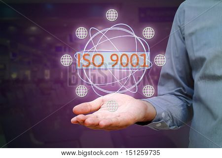 ISO 9001 standard for quality management of organizations with an auditor or manager business technology internet and virtual reality concept.