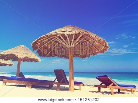Beach chairs on exotic tropical white sand beach, vacation concept