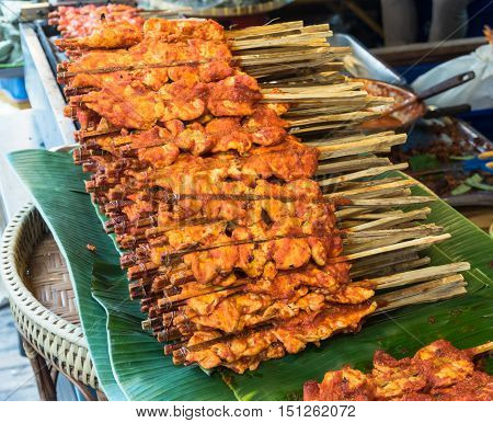 Grilled chicken skewer in spicy sauce for sale.