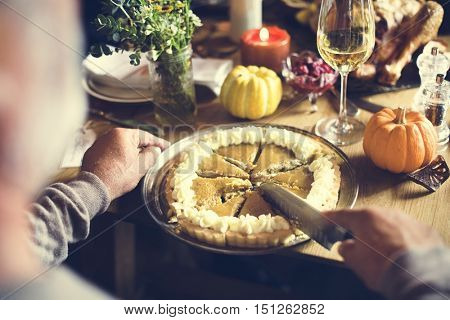 Hands Cutting Pumpkin Pie Thanksgiving Holiday Celebration Concept