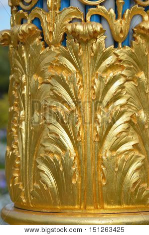 Fragment of rich floral decoration coated with gold