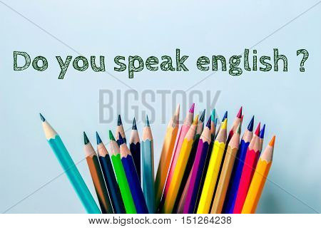 Text Do you speak english with color pencil on light blue background / vintage tone / business concept