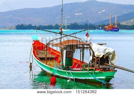 National wooden fishing boat in the sea water the ocean