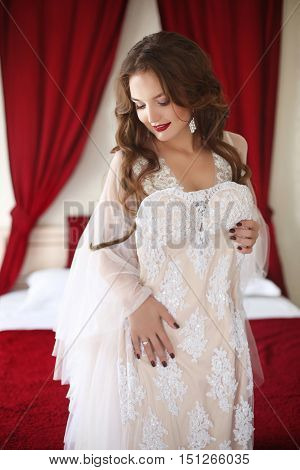 Beautiful Smiling Bride Woman Trying On Wedding Dress. Attractive Young Girl Model With Long Wavy Ha