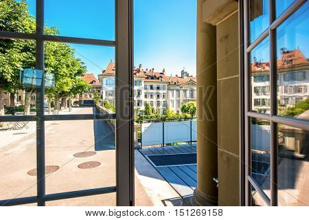 View from the window on the park and buildings near Munster church in the old town of Bern in Switzerland