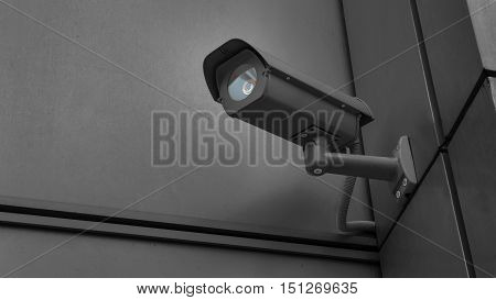 CCTV surveillance security camera equipment in dark tone tower home and house building on wall for safety system area control outdoor