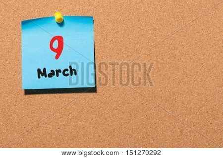 March 9th. Day 9 of month, calendar on cork notice board background. Spring time, empty space for text. poster