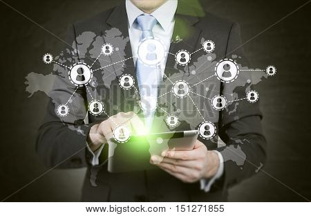 Close up of businessman holding tablet. Sketch of startup and world man are at the foreground. Double exposure.