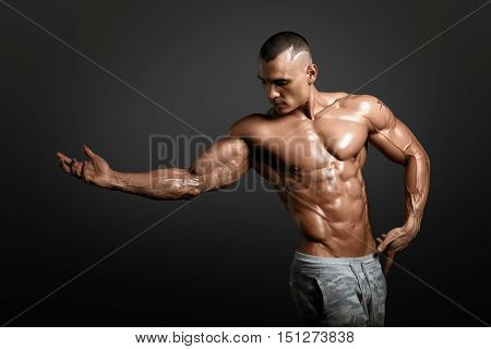 Strong Athletic Man Fitness Model Torso showing big muscles and exellent abs isolated with clipping path