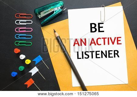 Text Be an active listener on white paper background / business concept