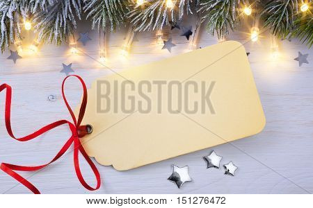 Merry Christmas card with Season Gift Tag on vintage background
