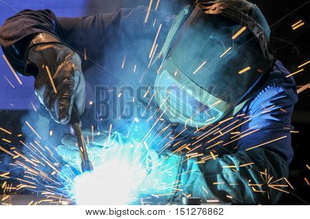 manufacturing industry, welder on work with protective mask