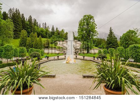 ETTAL GERMANY - JUNE 5 2016: Linderhof Palace and fountain group Flora and puttos in Bavaria Germany.