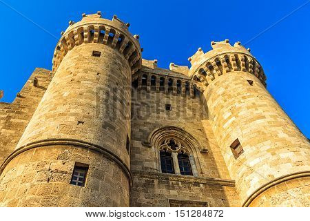Towers of the Grand Masters Palace before sunset. Medieval castle of the Hospitaller Knights on the island of Rhodes, Greece poster