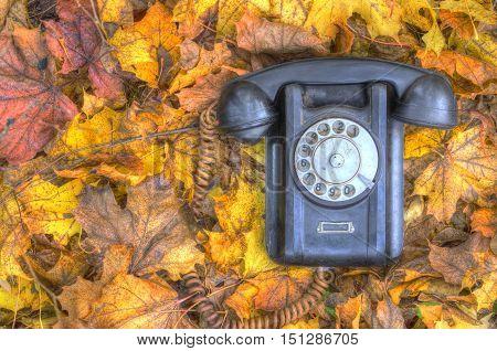 old broken phone on the autumn street HDR
