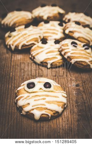 Fearful and frightened baked mummy biscuits freshly decorated for halloween cooking crafts