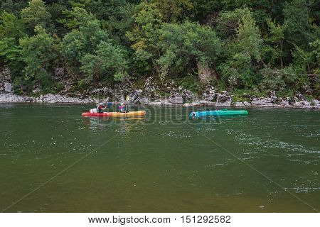 Pont d'Arc France - September 19 2016: Kayakers on the river Ardeche in France of which one has capsized.
