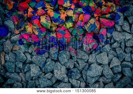 background dark gray stones and rocks in colorful neon colors view from above