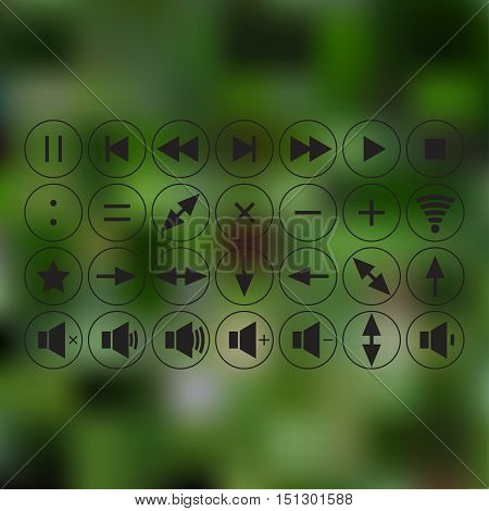 black icons. use in everyday life. signs - addition, multiplication, division, as well. Arrow keys - up, down, left, right. Buttons - rewind, stop, play, pause . green blurred background