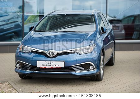 VILNIUS, LITHUANIA - AUGUST 7, 2016: Brand new Toyota Auris Touring Sports car. The Toyota Auris is a compact hatchback derived from the Toyota Corolla. The station wagon called the Touring Sports.