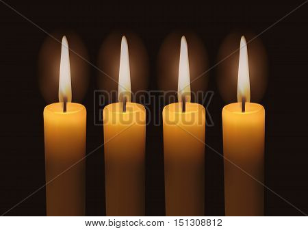 Four Lighted Advent Candles with dark background